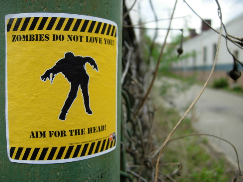 Zombie warning sign near Zombie Uprising live action game where airsoft guns are your only defence