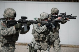 Three US Army soldiers taking aim with rifles – Surplus Store