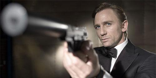 Daniel Craig as James Bond, posing with silenced gun similar to air pistol