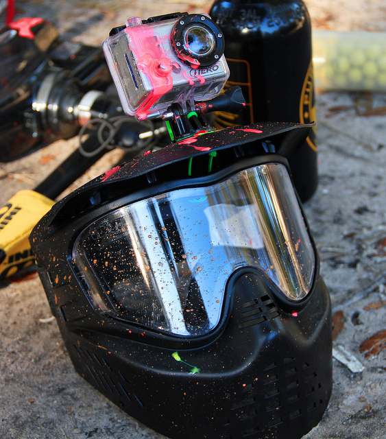 A helmet with GoPro attached after being shot with paintball guns and airsoft pistols