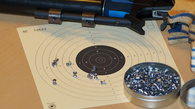 Close up of air rifle, target and pellets