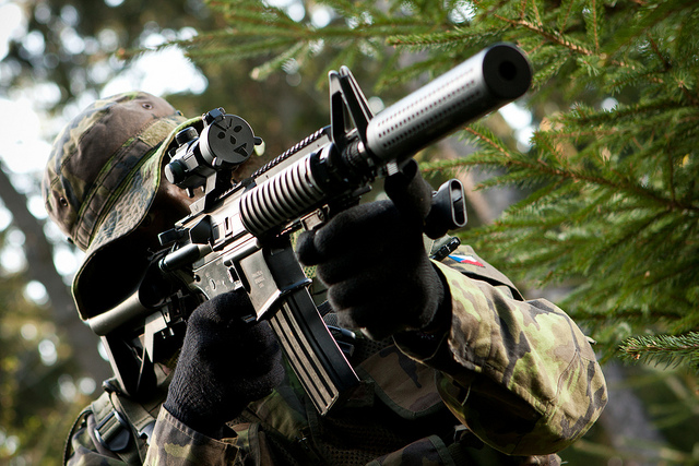 Man aiming down sights of airsoft guns UK