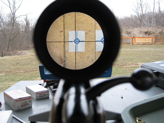 View down the sights of an air gun learning to shoot more accurately