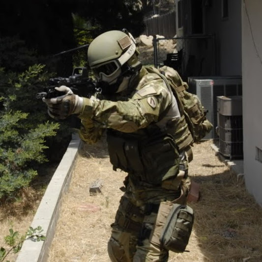 A man who built a custom airsoft loadout using gear from our airsoft store