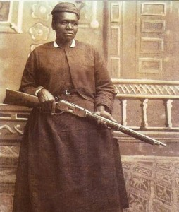 Stagecoach Mary Fields posing with a rifle in hand
