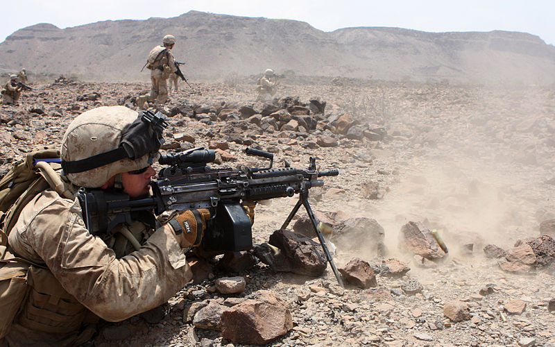 U.S. Marine providing covering fire with an M249