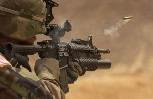 Soldier firing an M4 Carbine - airsoft gun version available at Surplus Store