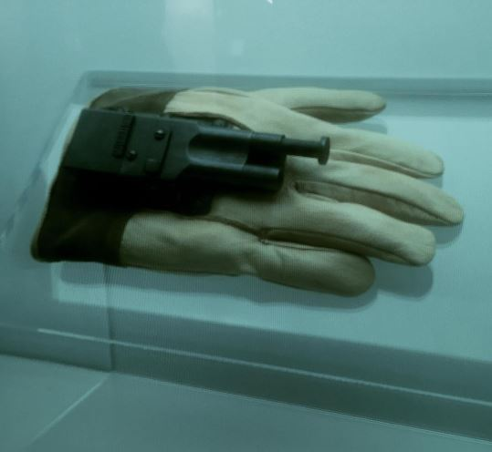 expertly crafted hidden glove gun