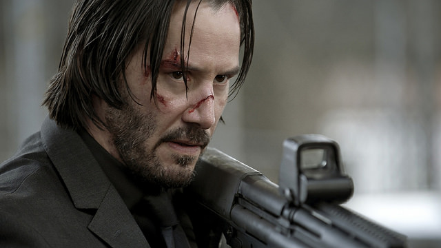 John Wick holding a rifle, a step up from the air gun