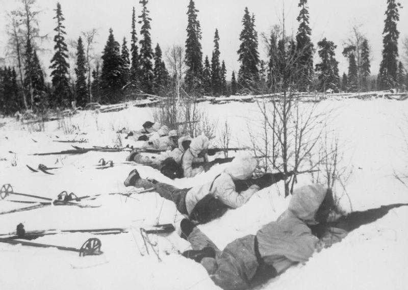 Finnish soldiers lying in position with their skis located next to them