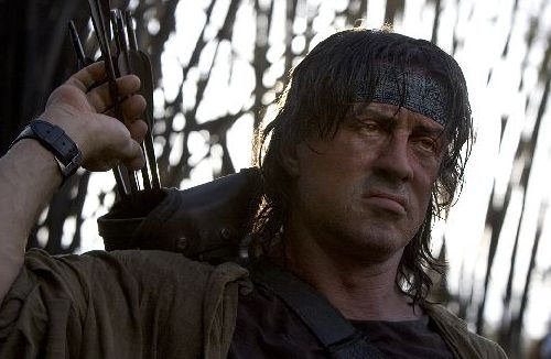 John Rambo pulling an arrow from a quiver