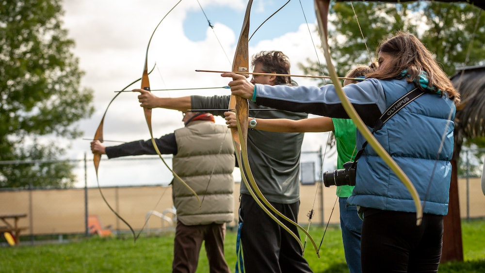 A group of children doing archery