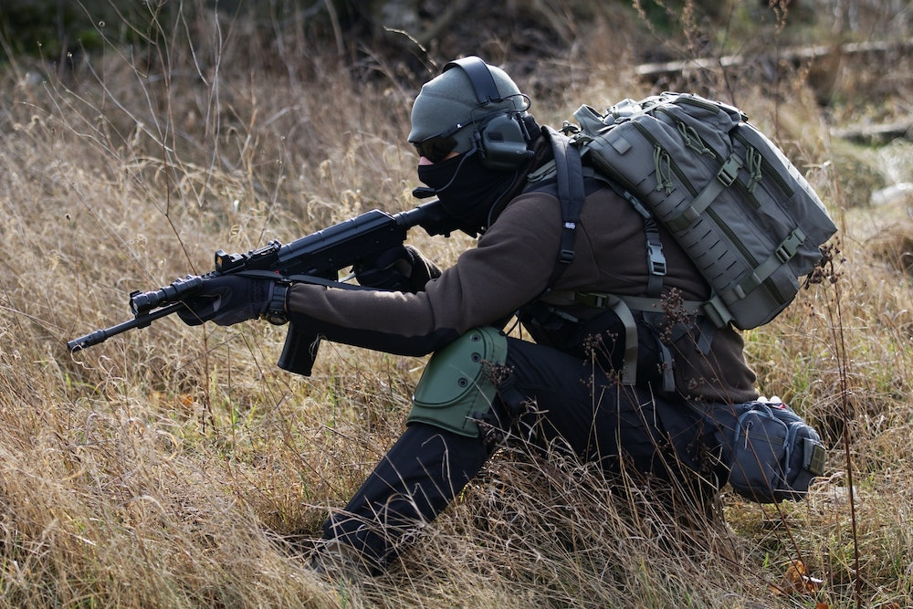 An airsoft player remaining low on game