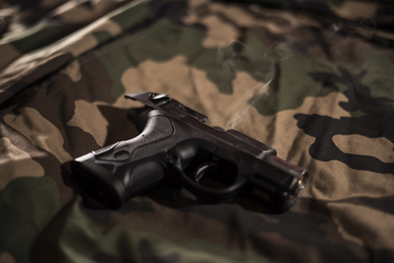 A bb gun against a camouflage background