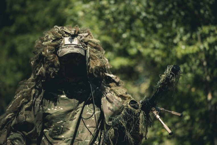 A sniper airsoft player