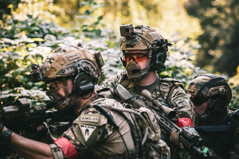 Three airsoft players wearing GoPros