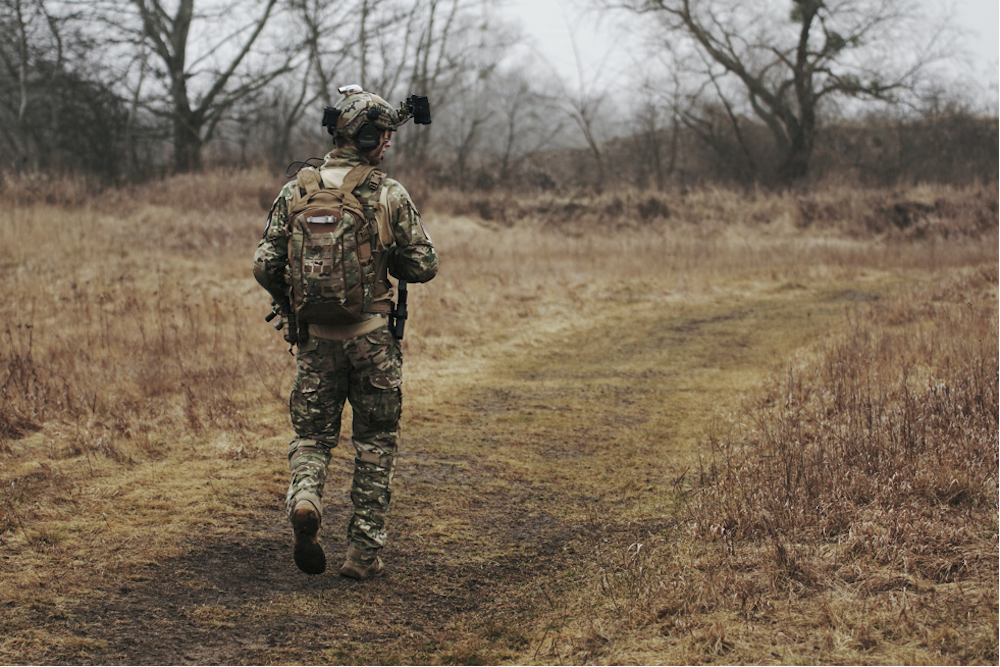 A man walking, ready to play some airsoft