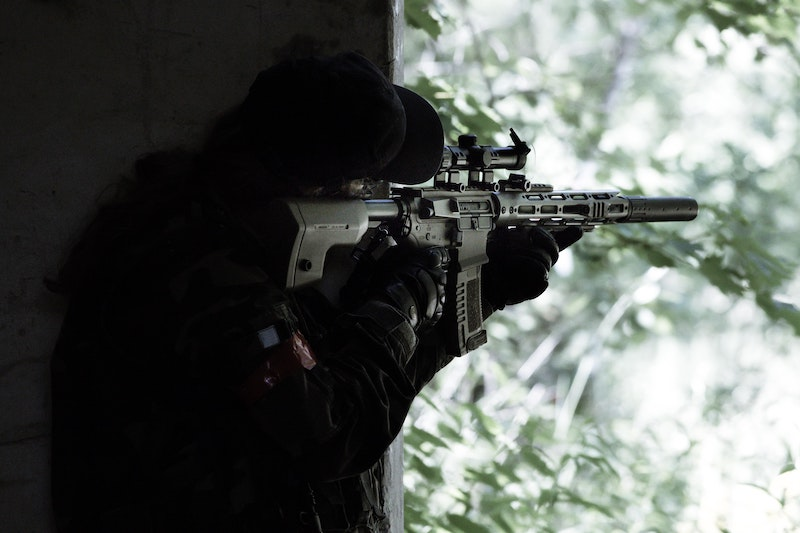 An airsoft player preparing to shoot