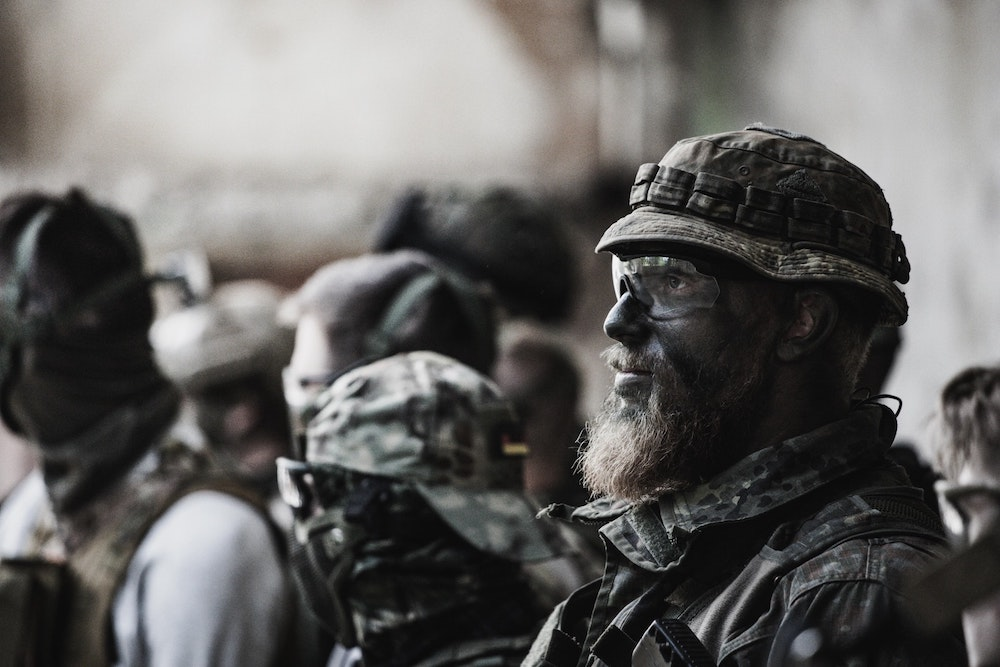 An airsoft player wearing eye protection glasses