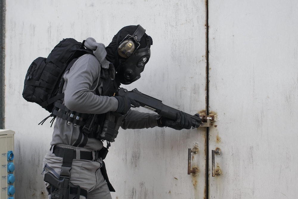 An airsoft player wearing a full face covering