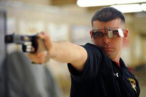 U.S Army Vet shooting an air pistol wearing glasses
