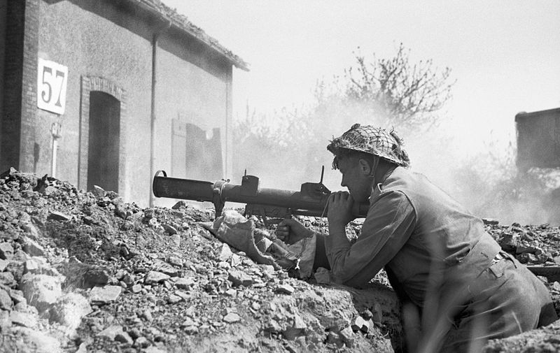 A soldier fires a PIAT near St Martin-des-Besaces, 1 August 1944.