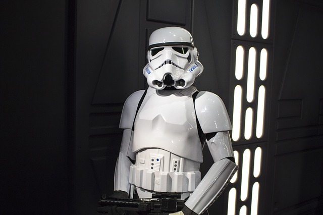 A Stormtrooper holding a blaster rifle.