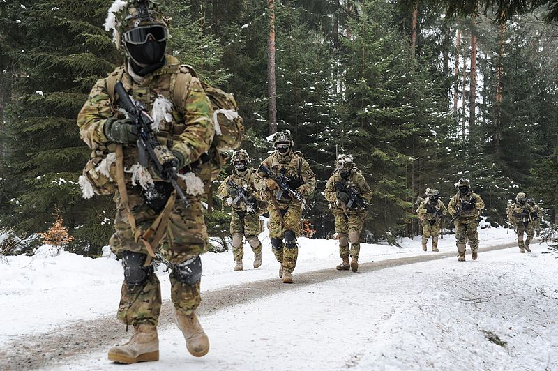 Winter airsofters dressed up warm for skirmish in the snow