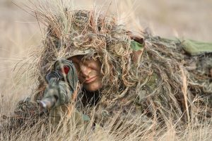 A sniper in a ghillie suit