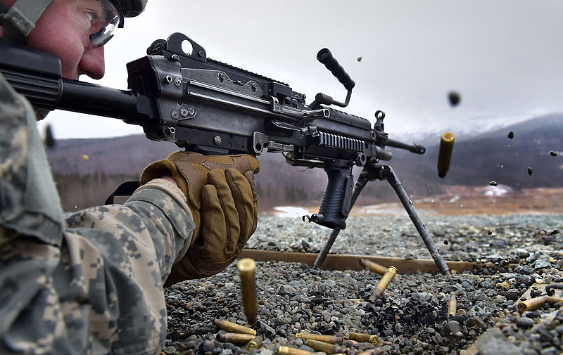 M249 being fired by soldier in prone position.