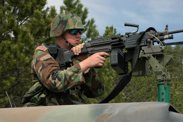 M249 support gunner in vehicle