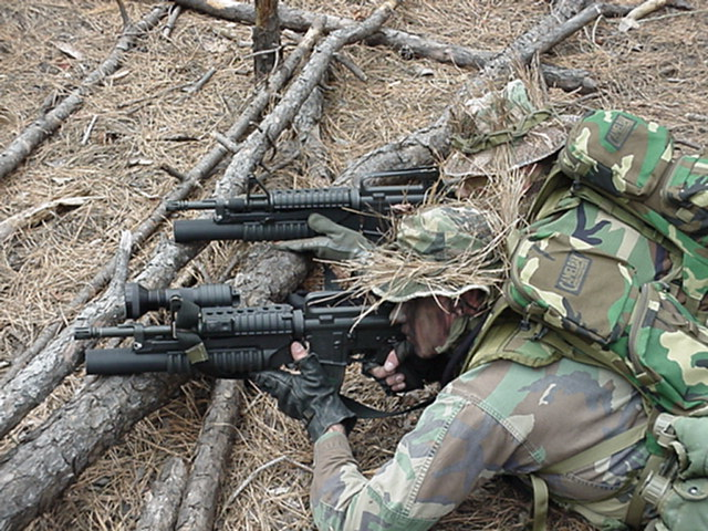 Two members of a recon team laying down