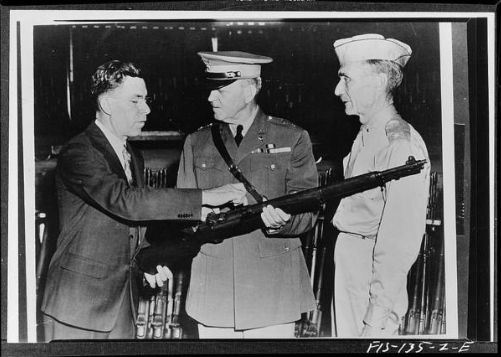 Garand shows rifle to generals.