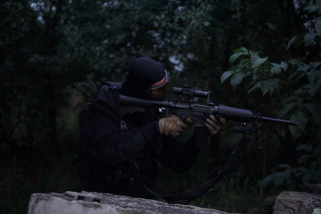 Person aiming with an air gun optic