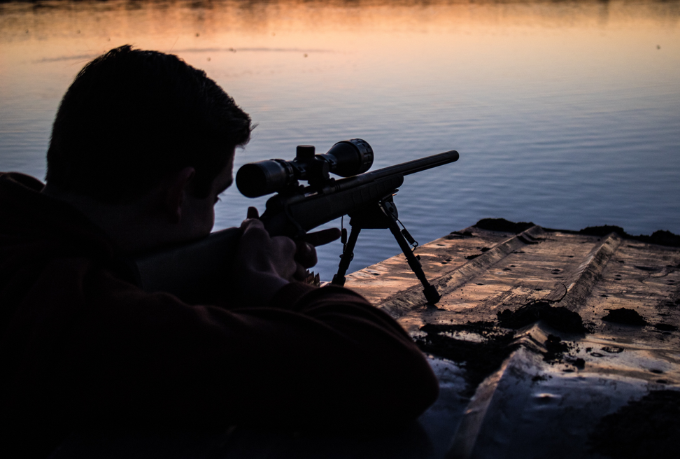 Sniper looking across the lake