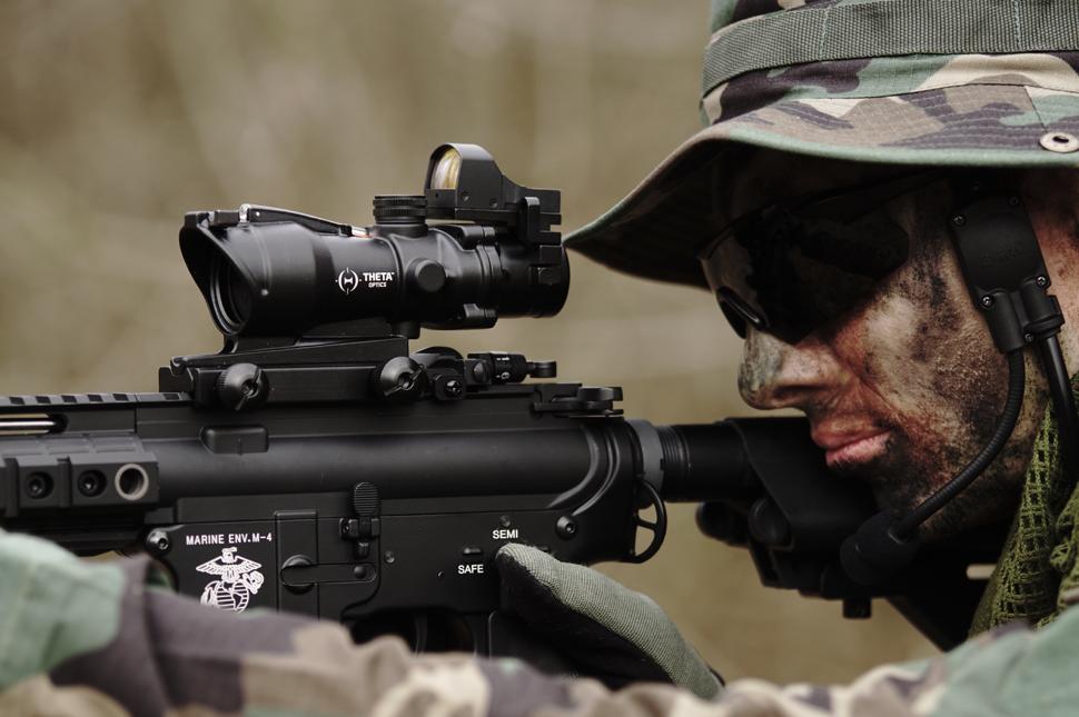 Solider looking down gun scope