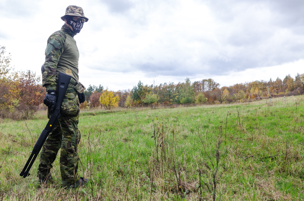 Man with airsoft gun in field
