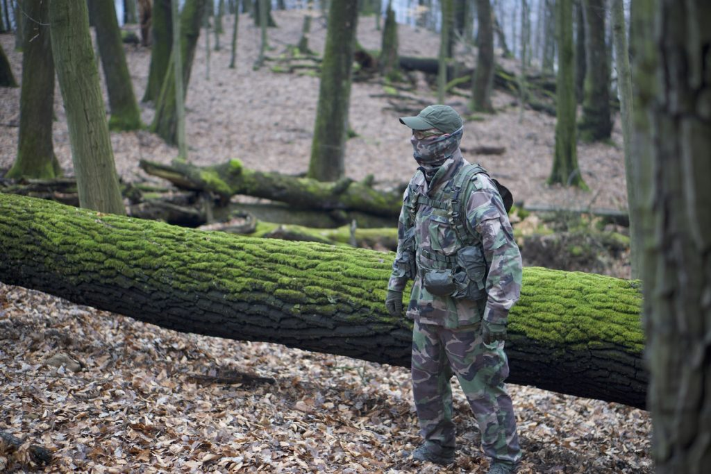 Man wearing camouflage gear for airsoft