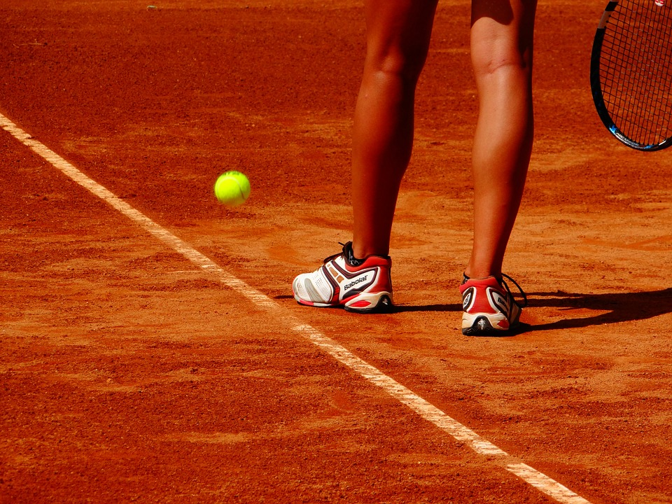 Woman playing tennis on clay court
