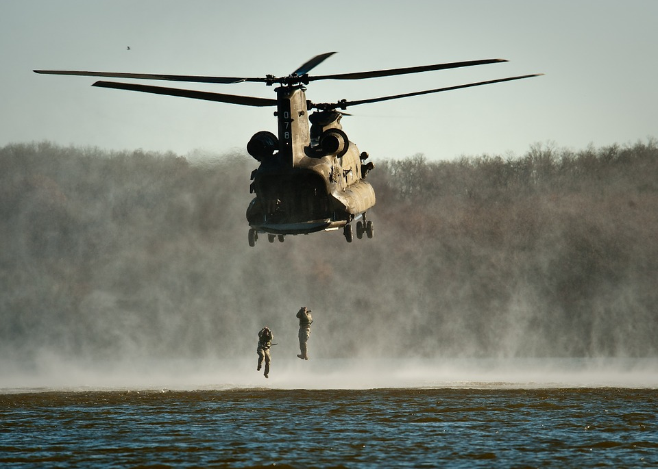 Marines training by jumping out of a helicopter