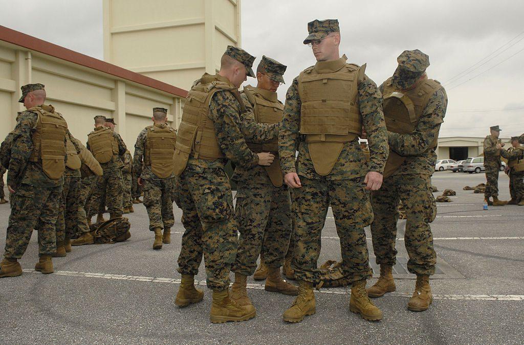 U.S. soldiers trying on bulletproof vests