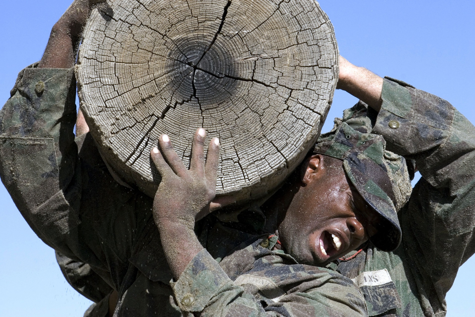 Soldiers training with log