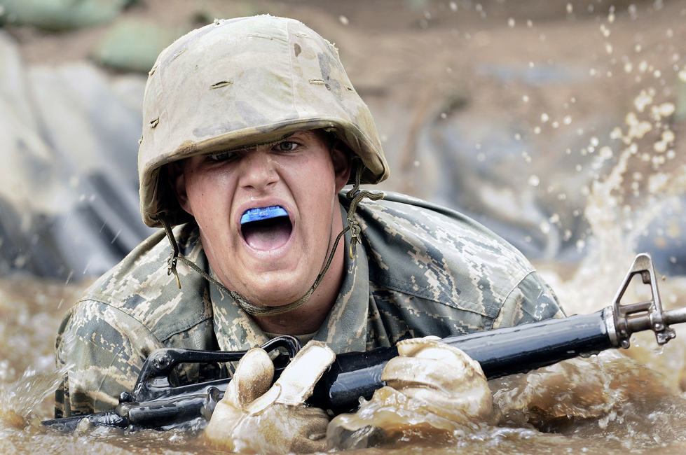 Soldiers crawling through water
