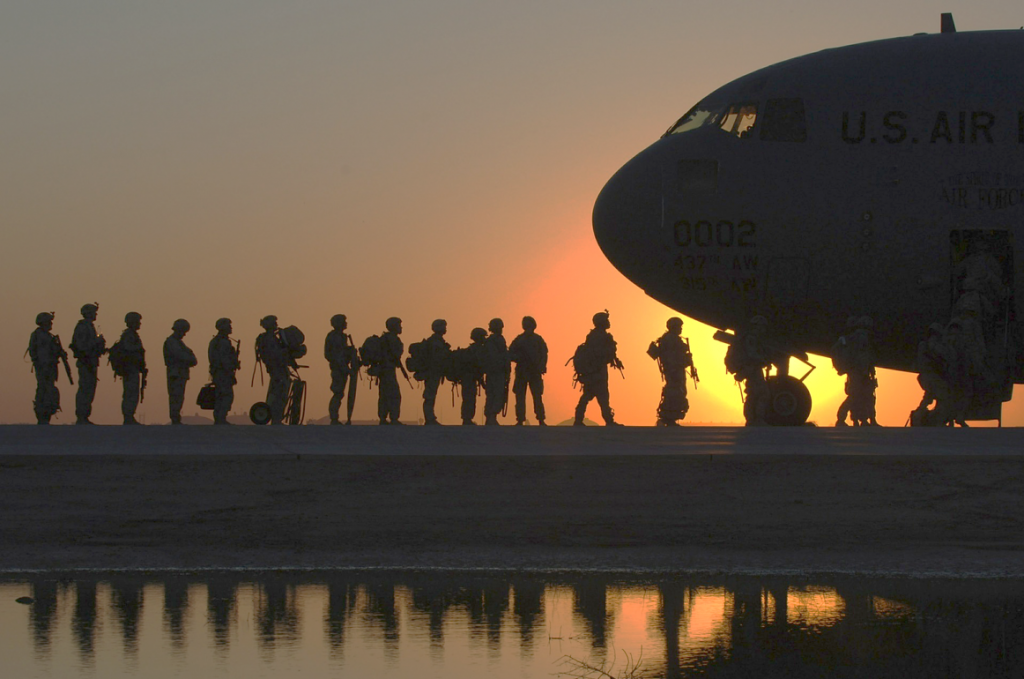 Military boarding a plane