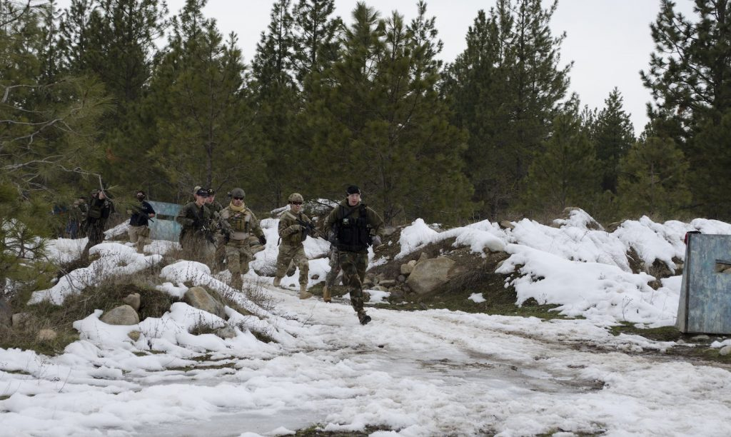 Team of airsofters in the snow