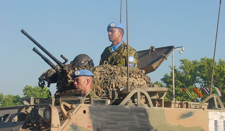 Blue beret soldier in a tank