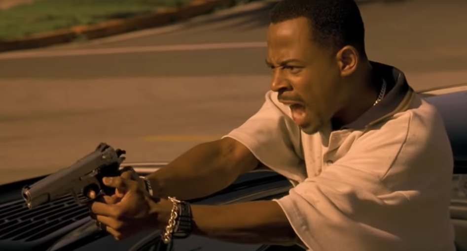Martin Lawrence firing a pistol from a car