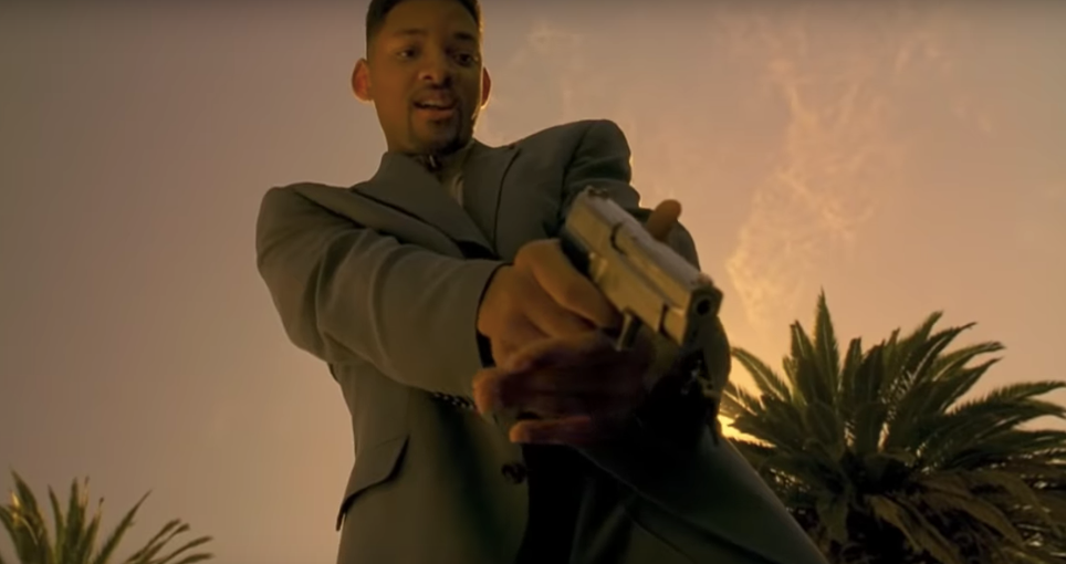 Will smith pointing a pistol downwards