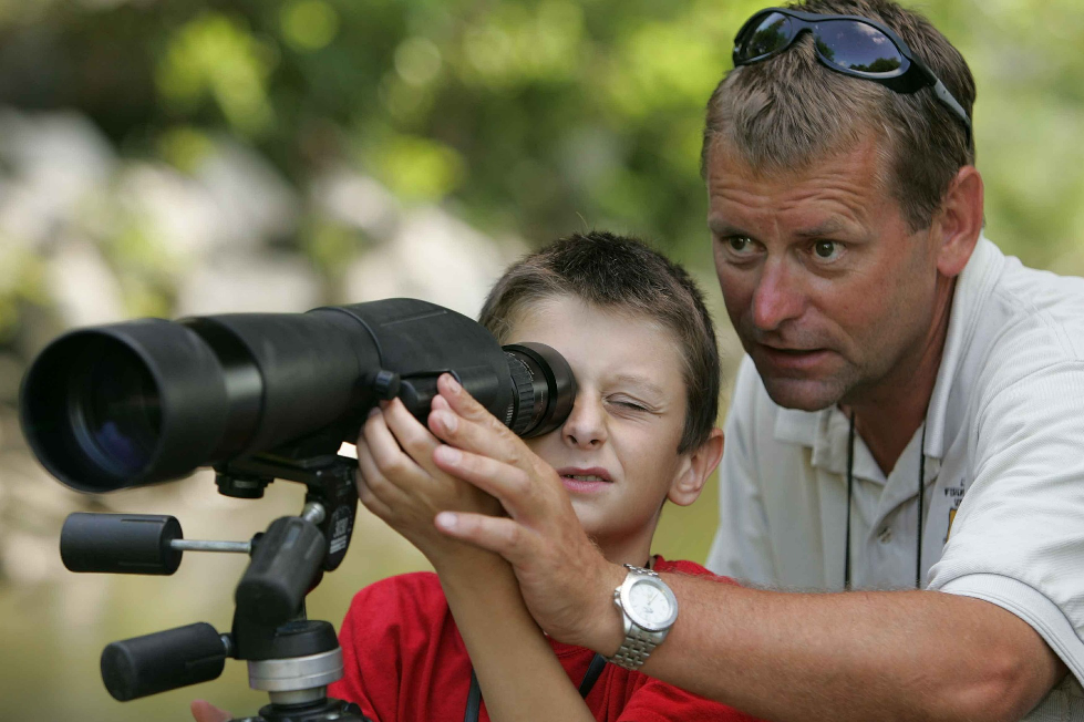 Person looking through spotting scope